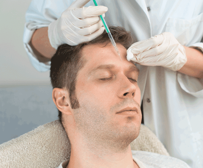 A man getting injected with facial Botox.