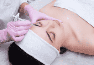 Woman getting a Botox treatment done.