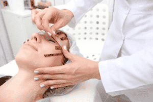 A woman being prepped for a liquid facelift