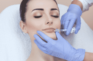 A woman being injected with Botox.